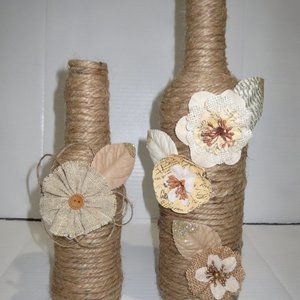 2 Jute wrapped wine bottle/vases. Burlap flowers.